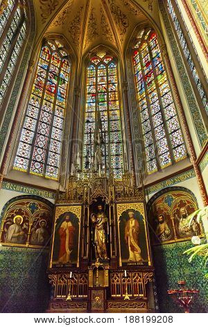 AMSTERDAM, NETHERLANDS - MARCH 30, 2017 Basilica Christ Crucifix Stained Glass De Krijtberg Church Amsterdam Holland Netherlands. Roman Catholic Church built in 1883 maybe the most beautiful church in Amsterdam.