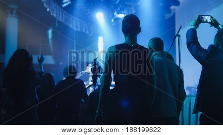 Absract blurred Young people stand near the stage during a concert at the club
