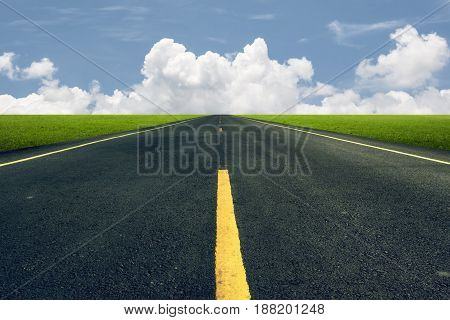 Landscape background. The road runs through nature. Beautiful nature