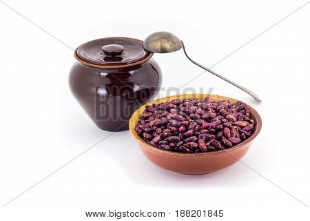 The Composition Of The Red Beans In A Clay Pial Next To A Clay Pot And A Copper Spoon,