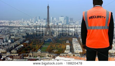 Security agent watching Paris from hilltop
