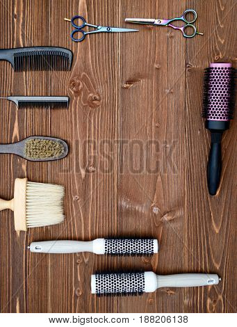 Hairdresser Tools On Wooden Background. Top View On Wooden Table With Scissors And Combl, Free Space