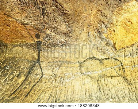 Buffalo Hunting. Paint Of Human Hunting On Sandstone Wall, Prehistoric Picture. Black Carbon Abstrac