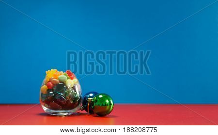 Colorful candy and jelly on background with copy space.