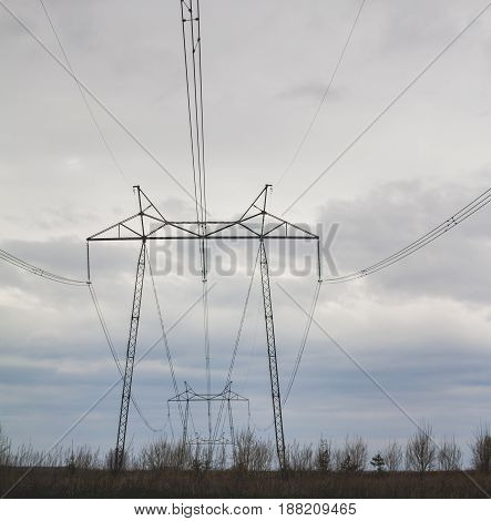 High-voltage wires against the grey of the autumn sky