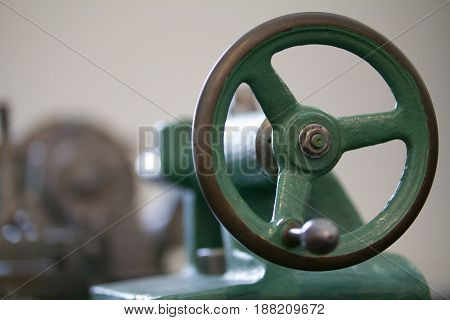 Blurred, Image of green metal handle antique lathe