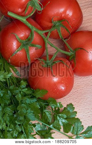 Red tomatoes for salad preparation, washed before cooking