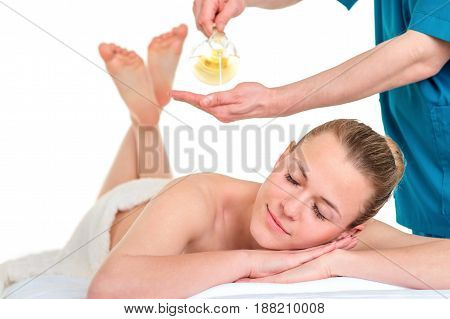 Man Therapist massaging female back. Relaxing spa procedures. Pleasure rest body care beauty alternative medicine concept