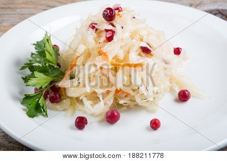 Pickled cabbage with red berries served on a plate