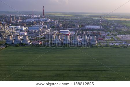 oil factory aerial view with chimneys oil tanks and pipe lines