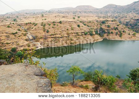 Lake in the deserted area. Toned photo. Lean Landscape in South India. View to the Lake in Maharashtra.