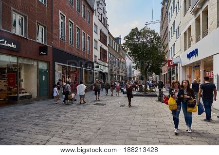 DUESSELDIRF, GERMANY - AUGUST 17, 2016: Tourists, visitors, and shoppers stroll along one of the Altstadt shopping streets.