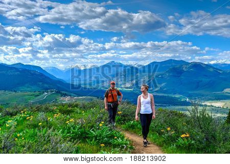Friends walking on meadows in North Cascades National Park. Cascade Mountains. Winthrop. Washington. The United States.