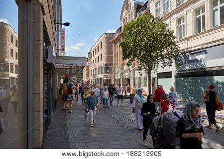 DUESSELDIRF, GERMANY - AUGUST 17, 2016: Visotors and tourists to the Altstadt come from all regions of the world to enjoy sightseeing and shopping in the scenic Rhineland atmosphere