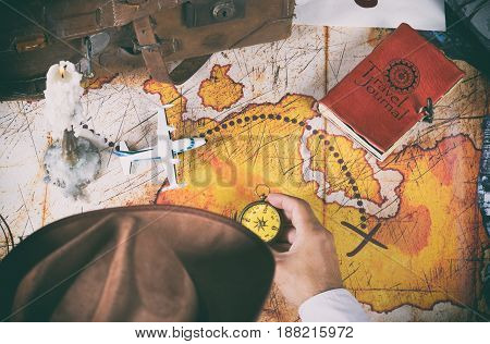 Explorer looking for a map with a treasure on an island