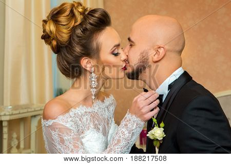 portrait of Just merried couple in love kissing
