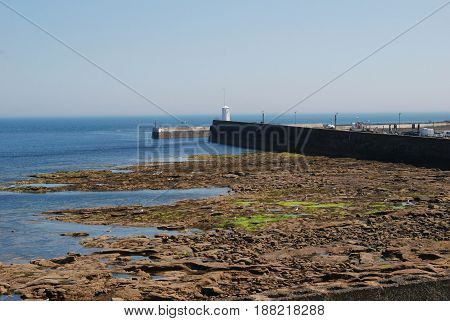 harbour wall and entrance at Seahouses Northumberland