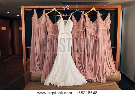 The bride's dress on a hanger in the room in Montenegro