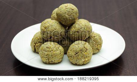 Vegan Chickpea Meatballs on White Plate on Wooden Table
