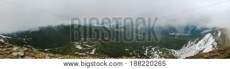 Carpathian landscape at evening mountain with fog