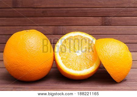 Arrangement of orange isolated on wooden background. Healthy food. A mix of fresh fruit. Group of citrus fruits. Vegetarian raw fruit. Nutrition for a healthy lifestyle.