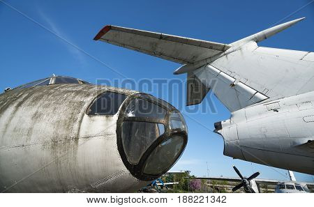 old rusty abandoned airplanes front close-up view