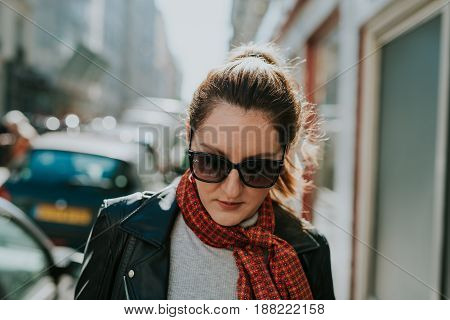 French woman walking on the streets of Paris