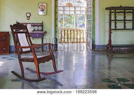 Goa, India - November 16, 2012: Rocking chair in Menezes Braganza Pereira House - old colonial Villa-Museum of Portuguese era with furniture and other decoration stuff of 16-18 century