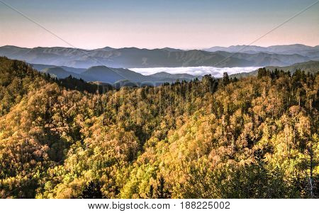 Smoky Mountain Mist. Mist rises from the valley of the Great Smoky Mountains National Park at the Newfound Gap Overlook on the border of North Carolina and Tennessee. Gatlinburg, Tennessee.