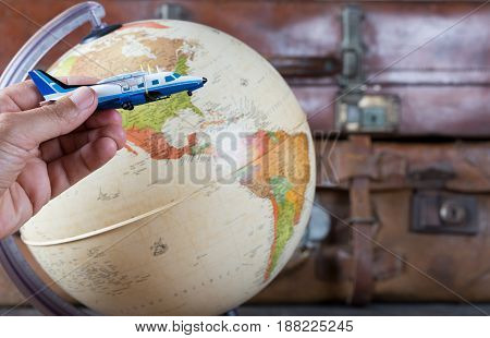 Map of the world next to an airplane