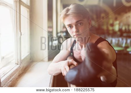 Male ballet dancer stretching at ballet barre close-up of foot