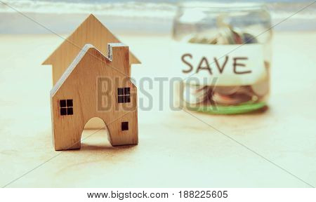 Little houses on sea view background,money saving for new houses and family.
