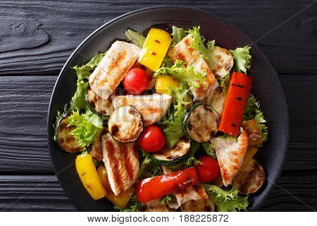 Salad With Grilled Chicken Breast And Summer Vegetables Closeup On Table. Horizontal Top View