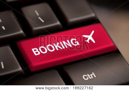 Booking flight by intenet. website e-ticket key business concept.