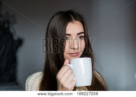 Young Attractive Woman Drinking Coffee At Home