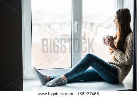 Young Beauty Woman Drink Coffee Near Window At Home