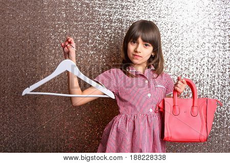 Small Pretty Smiling Girl With Red Leather Bag And Hanger