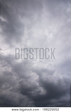Rainy heavy clouds of gray in the sky. Background