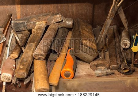 Old rusty tools hammers on the shelf of a locksmith
