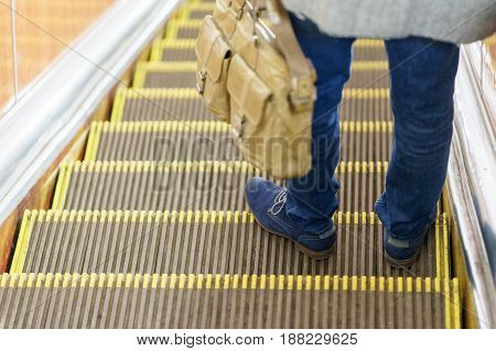 man standing in the subway on escalator