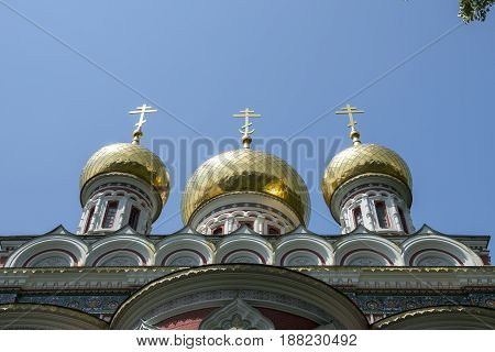 golden church domes in clear blue sky