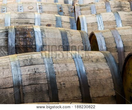Rows of Old Bourbon Barrels rolling on their sides