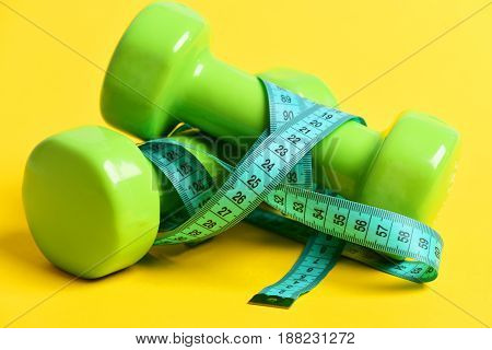Burning Calories Concept With Dumbbells And Measuring Tape