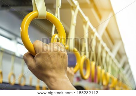Hand Of Man Holding On Handle Rail In Train