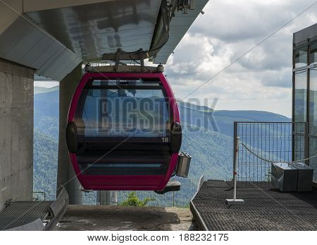 lift cabin in the mountains approaching station
