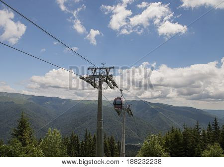 lift cabin in the mountains in clear sunny day