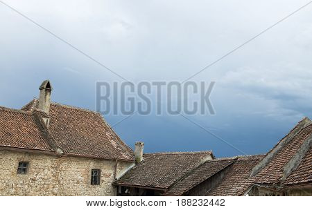 old houses roof with storm approaching day time