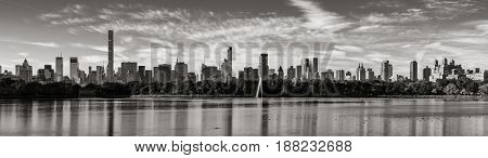 Morning panoramic view of Midtown Manhattan skyscrapers and the Central Park Reservoir in Black & White. New York City