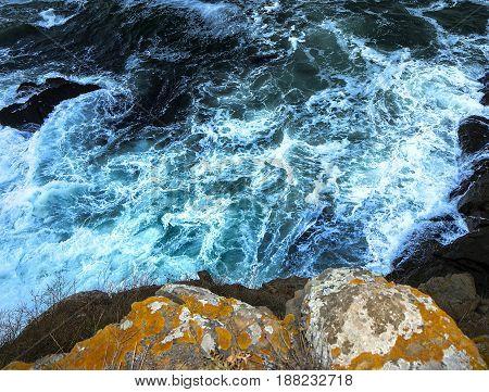 waves crashing on the rocks close view