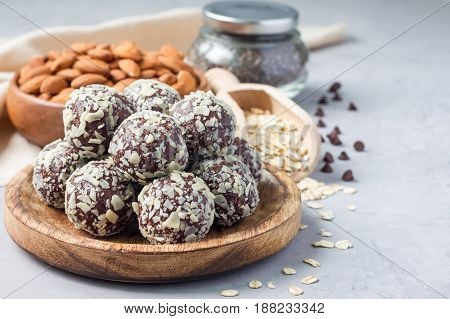 Healthy homemade paleo chocolate energy balls with rolled oats nuts dates and chia seeds horizontal copy space